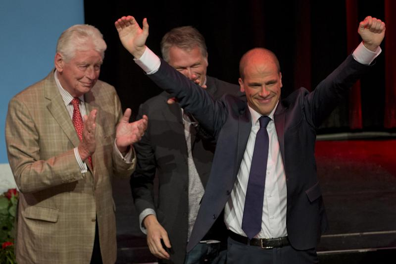 Labor Party Diederik Samsom, second right, celebrates with former Dutch prime minister Wim Kok, left, and former finance minister Wouter Bos, second left, after exit poll results of the parliamentary elections are announced in Amsterdam, Netherlands, Wednesday Sept. 12, 2012. An exit poll commissioned by the two biggest Dutch news broadcasters has predicted a narrow election victory for the Prime Minister Mark Rutte's free-market VVD party. The exit poll, which will be updated with late votes, gave the VVD 41 of the House of Representatives' 150 seats and the center-left Labor Party 40 votes. The poll has a 1.5 percent margin of error, and the broadcasters said the final result was still too close to call. (AP Photo/Peter Dejong)