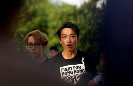 Members of Civil Human Rights Front Jimmy Sham speaks at a news conference in response to the announcement by Hong Kong Chief Executive Carrie Lam regarding the proposed extradition bill, outside the Legislative Council building in Hong Kong