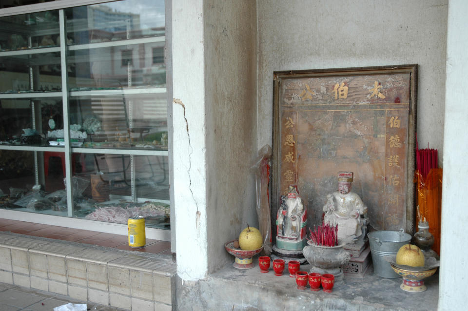 A shrine next to a shop in Singapore. (PHOTO: Getty Images)