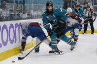 San Jose Sharks defenseman Brent Burns (88) reaches for the puck against the Colorado Avalanche during the second period of an NHL hockey game in San Jose, Calif., Monday, May 3, 2021. (AP Photo/Jeff Chiu)