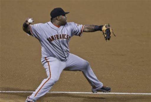 San Francisco Giants third baseman Pablo Sandoval makes the long throw from foul territory to get San Diego Padres' Jesus Guzman at first base and preserve the no hitter of Tim Lincecum in the seventh inning of a baseball game in San Diego, Saturday, July 13, 2013. (AP Photo/Lenny Ignelzi)