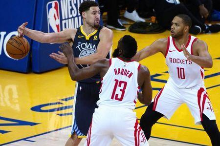 May 22, 2018; Oakland, CA, USA; Golden State Warriors guard Klay Thompson (left) loses control of the ball against Houston Rockets guard James Harden (13) and guard Eric Gordon (10) during the third quarter in game four of the Western conference finals of the 2018 NBA Playoffs at Oracle Arena. Mandatory Credit: Kelley L Cox-USA TODAY Sports