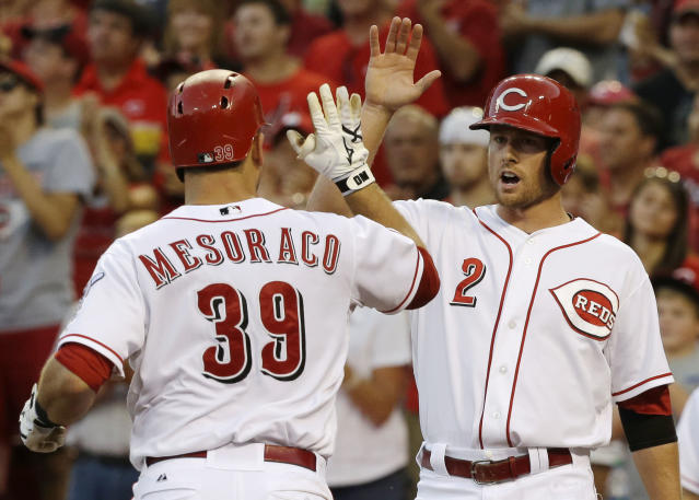 Cincinnati Reds' Devin Mesoraco (39) is congratulated by Zack Cozart (2) after Mesoraco hit a two-run home run off St. Louis Cardinals starting pitcher Jake Westbrook in the fourth inning of a baseball game, Saturday, Aug. 3, 2013, in Cincinnati. (AP Photo/Al Behrman)