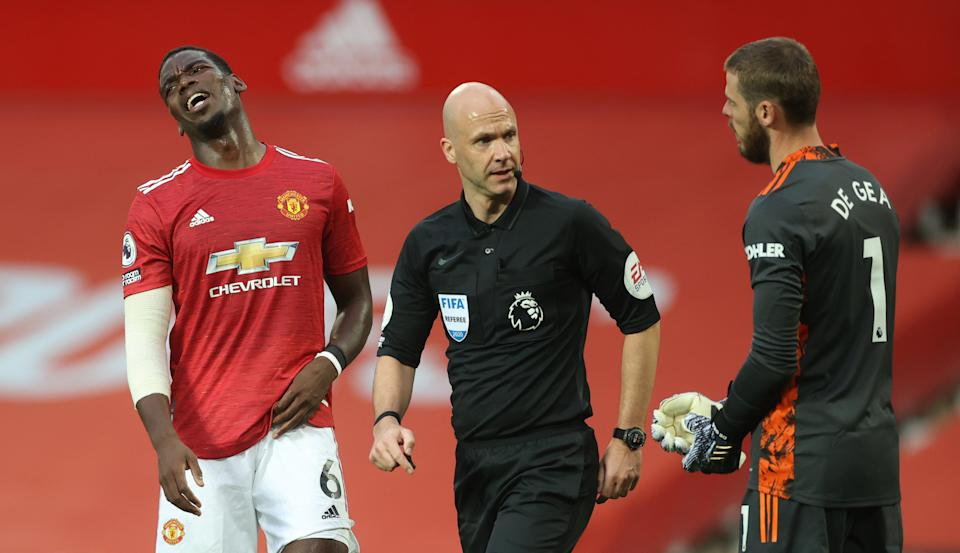 MANCHESTER, ENGLAND - OCTOBER 04: Paul Pogba and David De Gea react after Referee Anthony Taylor awards a penalty during the Premier League match between Manchester United and Tottenham Hotspur at Old Trafford on October 04, 2020 in Manchester, England. Sporting stadiums around the UK remain under strict restrictions due to the Coronavirus Pandemic as Government social distancing laws prohibit fans inside venues resulting in games being played behind closed doors. (Photo by Carl Recine - Pool/Getty Images)