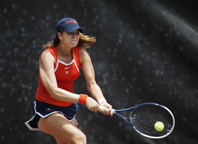 Virginia's Danielle Collins returns a shot during the final match of the NCAA women's tennis championship against California's Lynn Chi Monday, May, 26, 2014 in Athens, Ga.. (AP Photo/John Bazemore)
