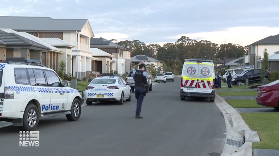 Police and ambulance are seen outside an Oran Park home.