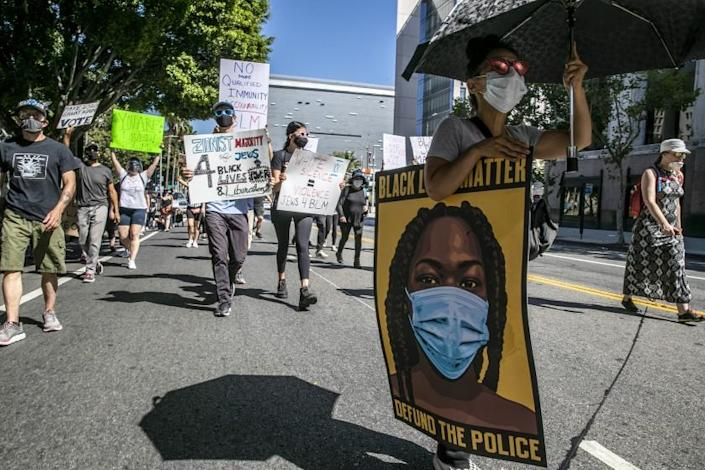"The recent spate of protests, such as this Black Lives Matter march in downtown Los Angeles on July 5, 2020, doesn't appear to have caused a surge in coronavirus infections, but incomplete testing makes it hard to be certain. <span class=""copyright"">(Los Angeles Times)</span>"
