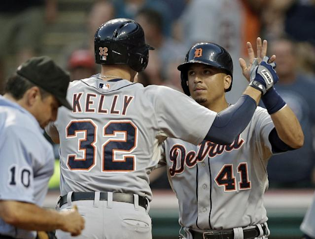 Detroit Tigers' Victor Martinez (41) greets Don Kelly (32) after Kelly's three-run home run in the fifth inning of a baseball game against the Cleveland Indians on Tuesday, Aug. 6, 2013, in Cleveland. (AP Photo/Mark Duncan)