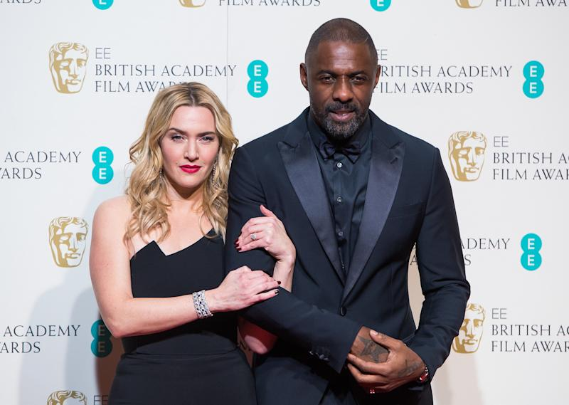 Kate Winslet and Idris Elba pose in the winners room at the EE British Academy Film Awards at The Royal Opera House on Feb. 14, 2016, in London, England. (Samir Hussein via Getty Images)