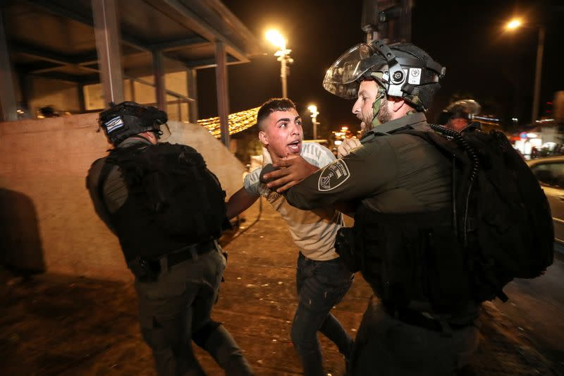 Israeli police detain a Palestinian at Jerusalem's Old City during clashes, as the Muslim holy fasting month of Ramadan continues, in Jerusalem