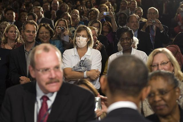 A woman wears a surgical mask in Bethesda, Md. Are masks really an effective way to keep yourself healthy and safe? (Photo: Jim Watson/AFP/Getty Images)