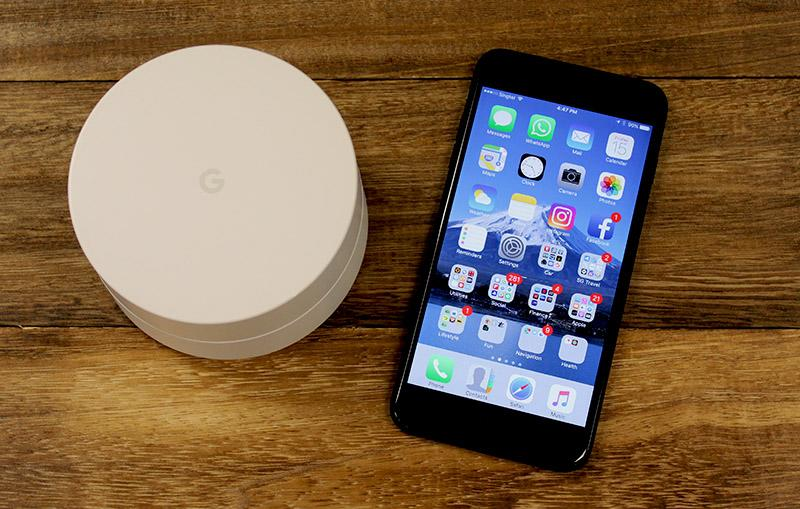 This is a Google Wifi node next to an iPhone 7 Plus.