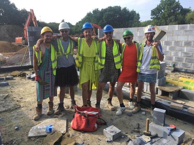 The bricklayers show off their good fashion sense on the job. (Photo: Chad Cusselle via Facebook)