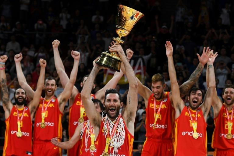 Spain's players celebrate winning the Basketball World Cup final against Argentina in Beijing on Sunday