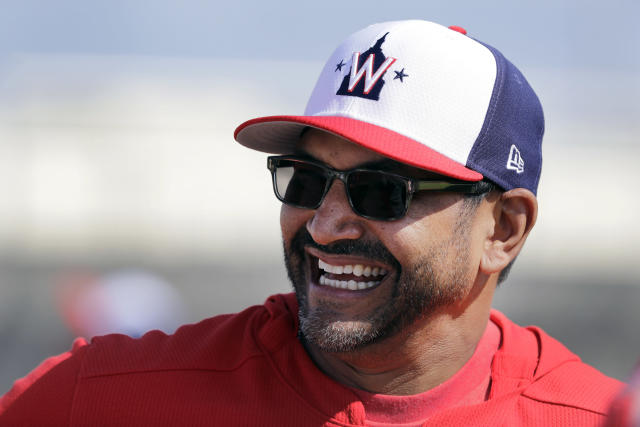 FILE - In this Feb. 16, 2019, file photo, Washington Nationals manager Dave Martinez laughs during spring training baseball practice, in West Palm Beach, Fla. Martinez heads into Year 2 on the job knowing that his team needs to play better, and win more, than it did in his first season. (AP Photo/Jeff Roberson, File)