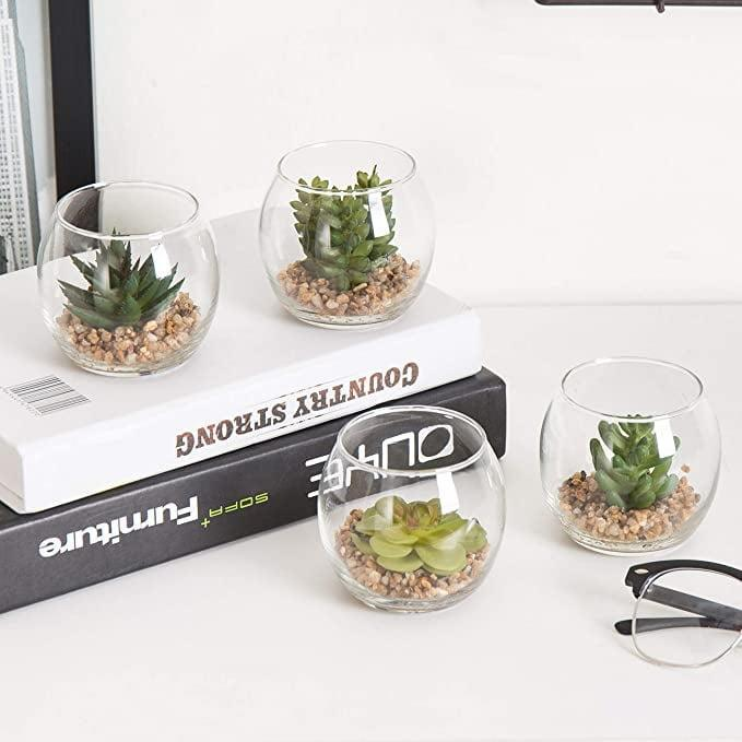<p>You can never go wrong with the <span>MyGift Set of 4 Mini Artificial Succulents in Round Glass Display Vases</span> ($25).</p>