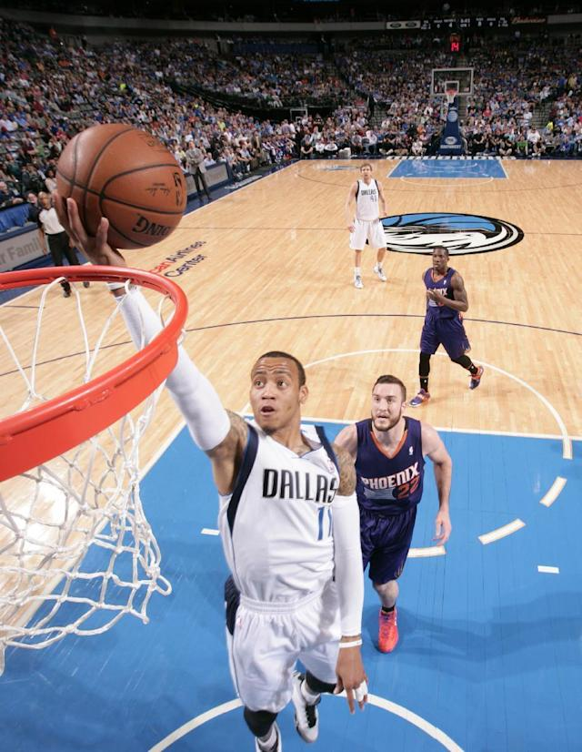 DALLAS, TX - APRIL 12: Monta Ellis #11 of the Dallas Mavericks shoots against the Phoenix Suns on April 12, 2014 at the American Airlines Center in Dallas, Texas. (Photo by Glenn James/NBAE via Getty Images)