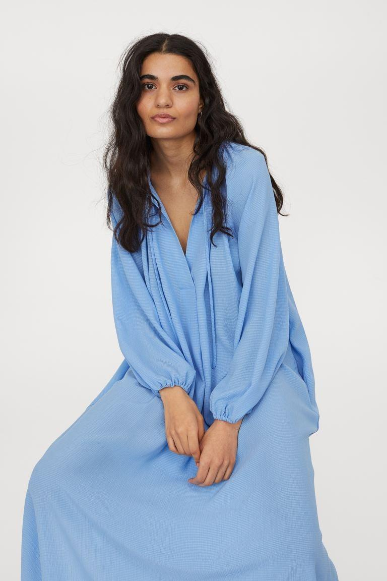 <p>TBH, we can't stop staring at the beautiful blue hue of this <span>H&amp;M Calf-length Dress</span> ($35).</p>