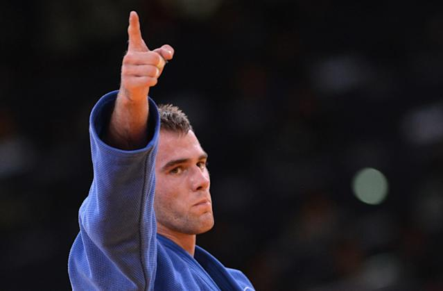 Canada's Antoine Valois-Fortier celebrates after winning against Azerbaijan's Elnur Mammadli during their men's -81kg judo contest match of the London 2012 Olympic Games on July 31, 2012 at the ExCel arena in London. AFP PHOTO / JOHANNES EISELEJOHANNES EISELE/AFP/GettyImages