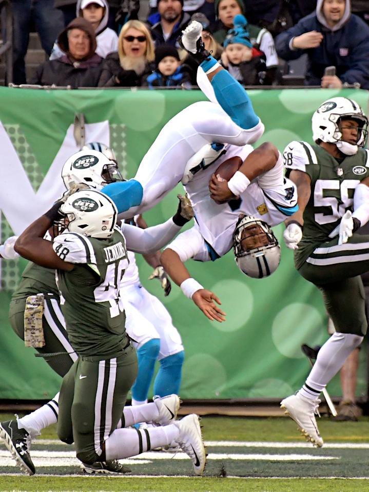 <p>Carolina Panthers quarterback Cam Newton (1) dives over a tackle-attempt by New York Jets outside linebacker Jordan Jenkins (48) on a two-point conversion during the second half of an NFL football game, Sunday, Nov. 26, 2017, in East Rutherford, N.J. (AP Photo/Bill Kostroun) </p>