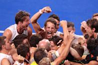 <p>Team Belgium celebrates their victory in the Men's Gold Medal match between Australia at Oi Hockey Stadium on August 5.</p>
