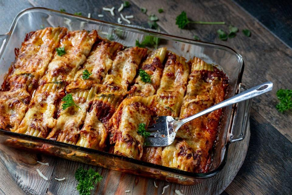 <p>Manicotti tends be used in the same way as cannelloni tubes. So stuffed with a tasty filling, then covered in Béchamel sauce and baked.</p>