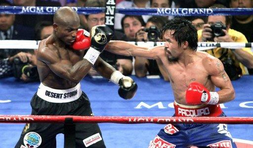 Bradley (L) was awarded the victory in a split decision triumph that ended Pacquiao's 15-fight victory streak