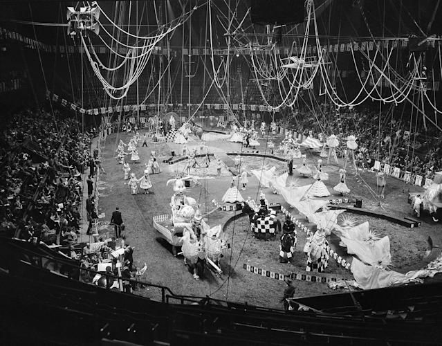 <p>Gaily costumed circus performers and animals dance their way over the Madison Square Garden tanbark in a Celestial Calendar Cavalcade, during rehearsal in New York, March 30, 1955, for opening of the 1955 edition of Ringling Brothers and Barnum and Bailey Circus. The cavalcade is one of 26 displays in the show which starts its annual tour with the current New York booking. (AP Photo/Matty Zimmerman) </p>