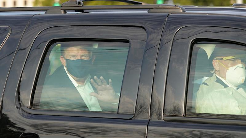 Trump leaves hospital for brief motorcade ride as doubts over his condition persist