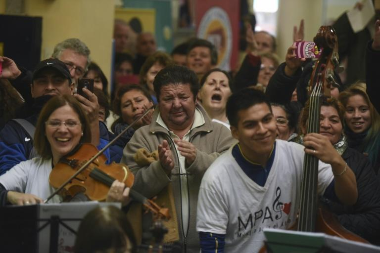 Volunteer members of Musica Para el Alma (Music for the Soul) give a flash mob concert in the main hall of the Alvarez Hospital in Buenos Aires in June