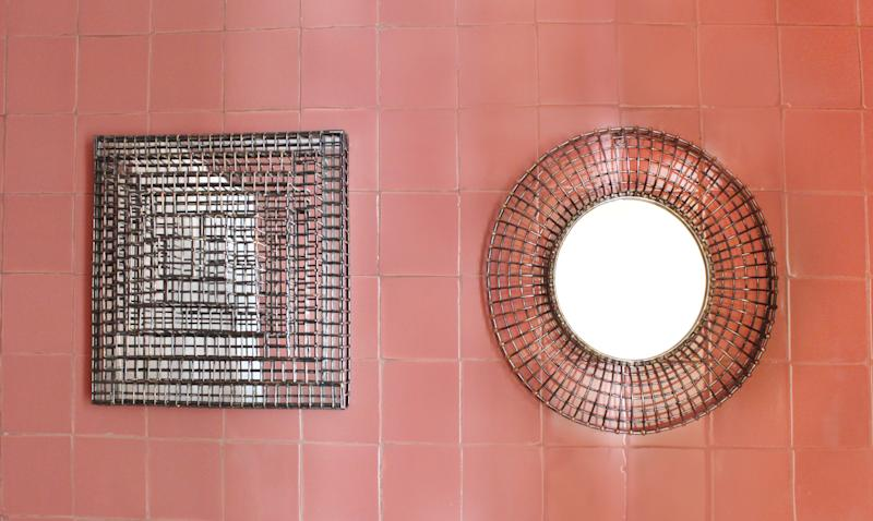 Cage mirrors by Anndra Neen.