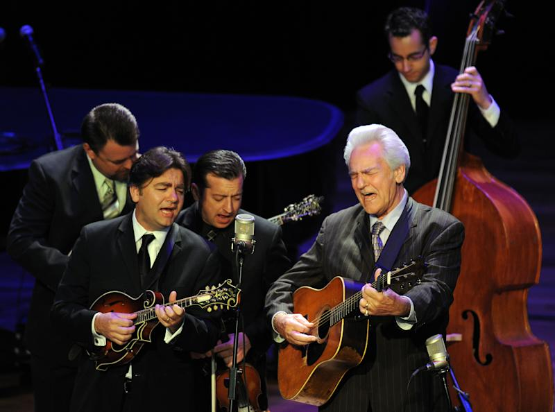 Del McCoury, playing guitar, leads his band during the funeral service for banjo great and bluegrass pioneer Earl Scruggs at the Ryman Auditorium on Sunday, April 1, 2012, in Nashville, Tenn. Scruggs died  Wednesday, March 28, 2012. He was 88. (AP Photo/Joe Howell, Pool)