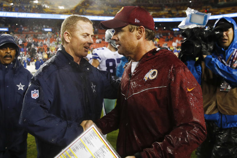 FILE - In this Oct. 29, 2017, file photo, Dallas Cowboys head coach Jason Garrett, left, greets Washington Redskins head coach Jay Gruden after an NFL football game in Landover, Md. Neither Gruden's Redskins nor Garrett's Cowboys has managed to win two games in a row this season, but both are coming off victories as they renew their NFC East rivalry Sunday. (AP Photo/Patrick Semansky, File)