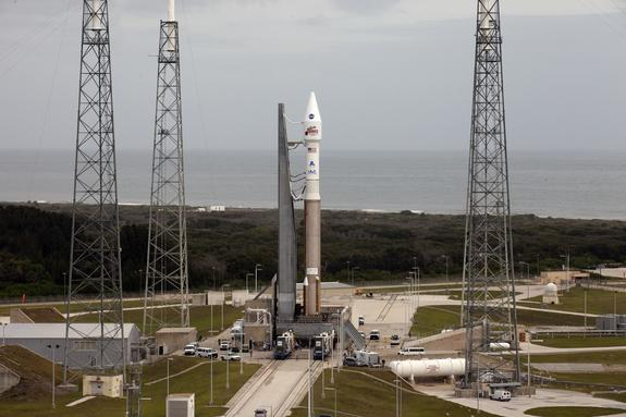 A United Launch Alliance Atlas 5 rocket stands poised to launch NASA's Mars Atmosphere and Volatile EvolutioN (MAVEN) spacecraft toward Mars from Cape Canaveral Air Force Station after being rolled out to the launch pad on Nov. 16, 2013. Lifto