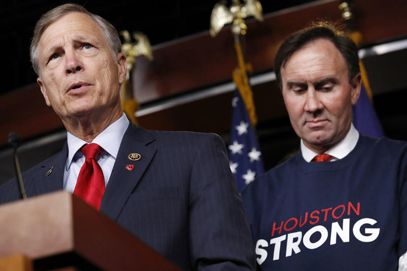 Rep. Brian Babin, R-Texas, left, speaks about the emergency funding bill for Harvey relief efforts, Wednesday, Sept. 6, 2017, during a news conference on Capitol Hill in Washington. At right is Rep. Pete Olson, R-Texas. (AP Photo/Jacquelyn Martin)