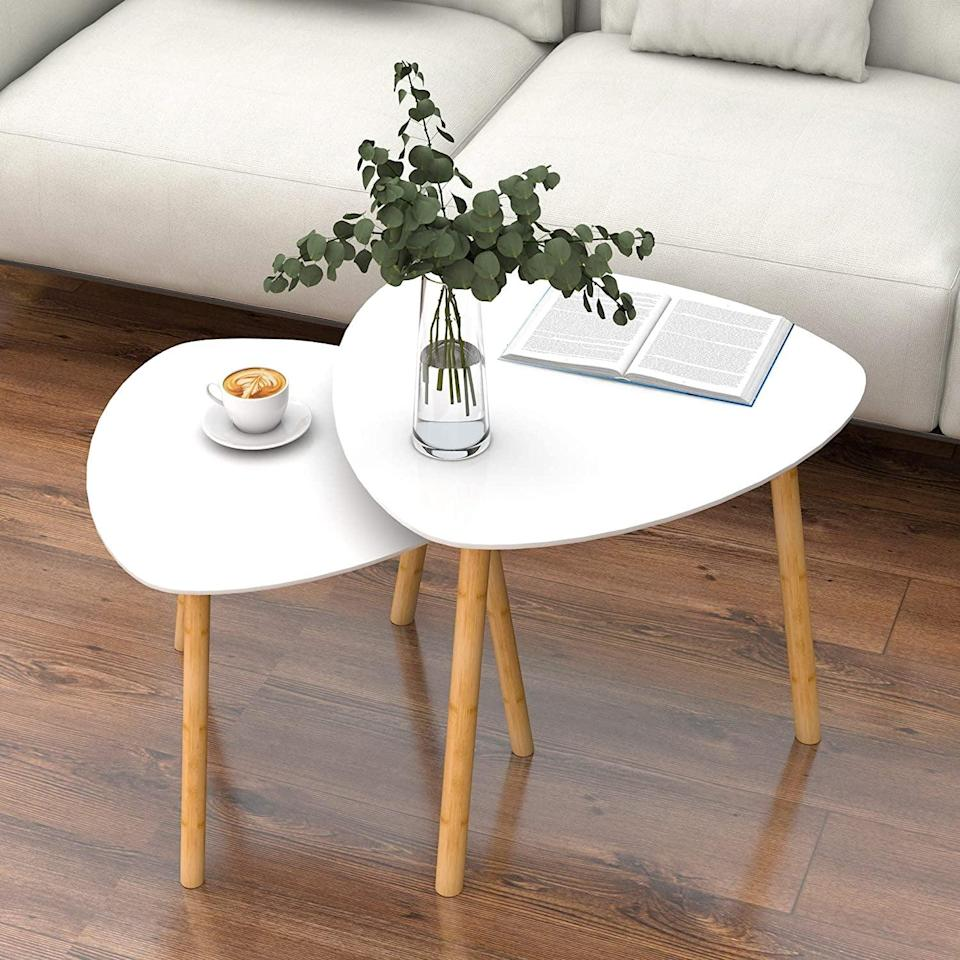 <p>These contemporary <span>Nesting Table Set of 2 - Bamboo End Table</span> ($42) look so sleek and stylish. It's perfect for your living room or even as accent tables in your bedroom.</p>