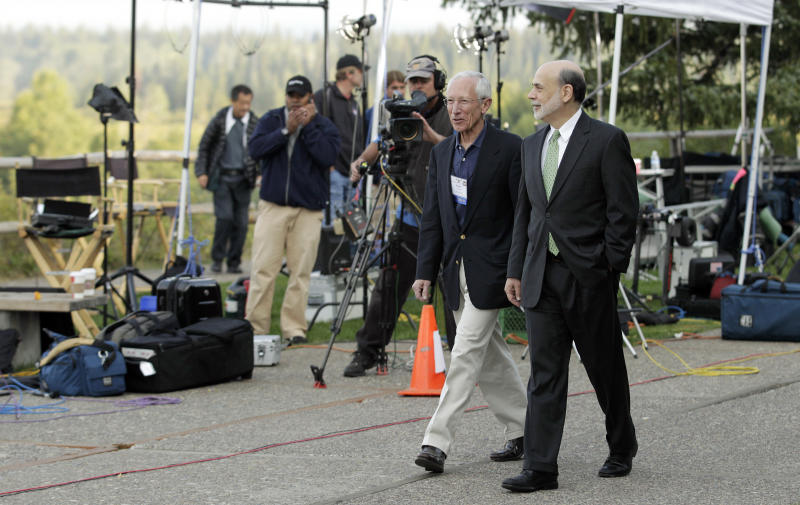 "Federal Reserve Chairman Ben Bernanke, right, and Bank of Israel Governor Stanley Fischer walk together past television cameras outside of the Jackson Hole Economic Symposium, Friday, Aug. 31, 2012, at Grand Teton National Park near Jackson Hole, Wyo. Bernanke made clear Friday that the Federal Reserve will do more to boost the economy because of high U.S. unemployment and an economic recovery that remains ""far from satisfactory."" (AP Photo/Ted S. Warren)"