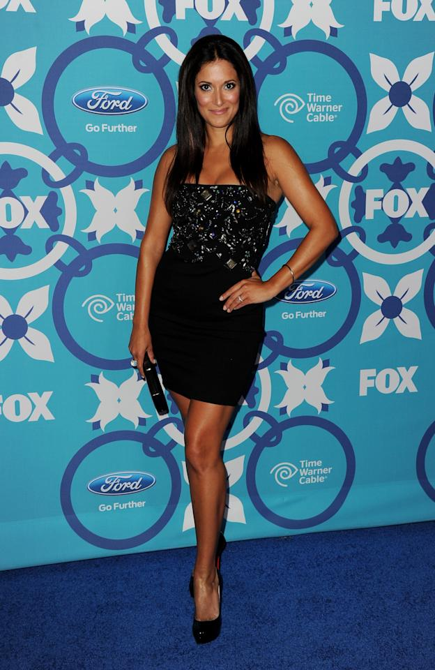 SANTA MONICA, CA - SEPTEMBER 09: Actress Angelique Cabral arrives at the Fox Fall Eco-Casino Party at The Bungalow on September 9, 2013 in Santa Monica, California. (Photo by Kevin Winter/Getty Images)