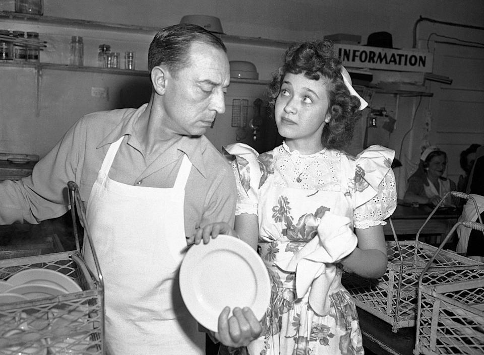 Drying the dishes with Buster Keaton at the Hollywood Canteen, April 1944 - AP