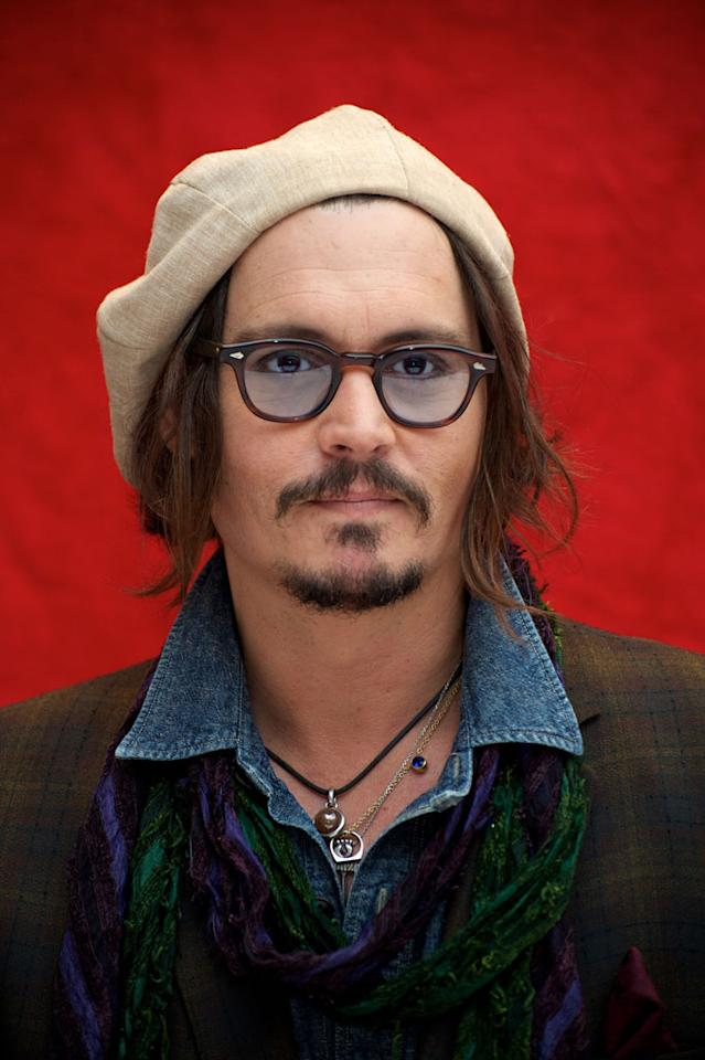 This is a picture of Johnny Depp wearing a hat. Probably a windsor hat or a8711199f70