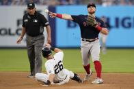 Boston Red Sox's Christian Arroyo, right, throws out New York Yankees' Giancarlo Stanton (not shown) at first base after forcing out Yankees' DJ LeMahieu, center, for a double play during the first inning of a baseball game Friday, July 16, 2021, in New York. (AP Photo/Frank Franklin II)
