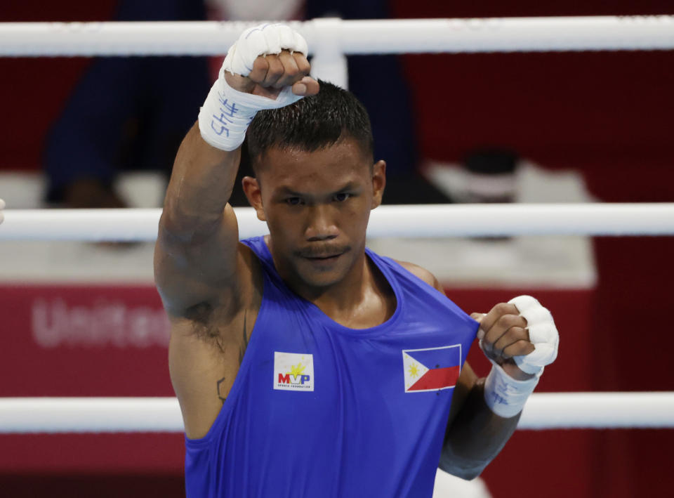 Tokyo 2020 Olympics - Boxing - Men's Middleweight - Last 16  - Kokugikan Arena - Tokyo, Japan - July 29, 2021. Eumir Marcial of the Philippines wins the fight. REUTERS/Ueslei Marcelino
