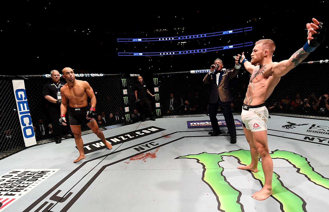 """<p>McGregor became the UFC's first """"champ-champ,"""" starting a trend which saw Daniel Cormier and then Amanda Nunes also hold belts in two divisions simultaneously. This was the UFC's first event in New York since the ban on MMA was lifted and it attracted a massive gate of more than $17 million to Madison Square Garden. McGregor's fast hands were the difference as he was landing clean, hard shots that Alvarez couldn't deal with, and the fight was stopped in the second. It made McGregor the UFC lightweight champion while he was also holding the featherweight belt. </p>"""