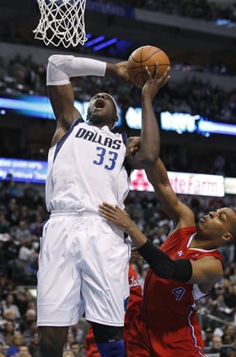 Dallas Mavericks center Brendan Haywood (33) is fouled by Los Angeles Clippers guard Randy Foye (4) during the first half of an NBA basketball game in Dallas, Monday, Feb. 13, 2012. The Mavericks won 96-92. (AP Photo/LM Otero)