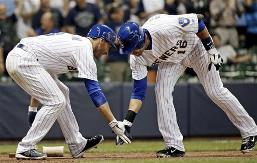 Milwaukee Brewers' Aramis Ramirez (16) is congratulated by Ryan Braun after hitting a two-run home run during the eighth inning of a baseball game against the Pittsburgh Pirates Friday, Aug. 31, 2012, in Milwaukee. (AP Photo/Morry Gash)