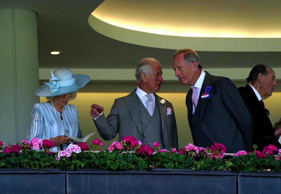 The Prince of Wales and the Duchess of Cornwall in the Royal Box on day one of Royal Ascot at Ascot Racecourse. Picture date: Tuesday June 15, 2021.