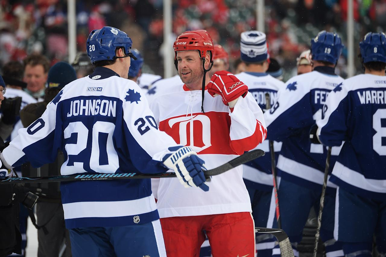 DETROIT, MI - DECEMBER 31: Mike Johnson #20 of the Toronto Maple Leafs talks with Aaron Ward #27 of the Detroit Red Wings following the end of the first game of the 2013 Hockeytown Winter Festival Alumni Showdown on December 31, 2013 at Comerica Park in Detroit, Michigan. (Photo by Jamie Sabau/Getty Images)