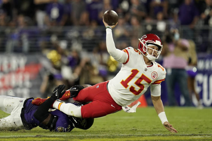 Kansas City Chiefs quarterback Patrick Mahomes makes a pass attempt as he is tackled by Baltimore Ravens linebacker Odafe Oweh in the second half of an NFL football game, Sunday, Sept. 19, 2021, in Baltimore. Ravens cornerback Tavon Young intercepted the pass attempt on the play. (AP Photo/Julio Cortez)