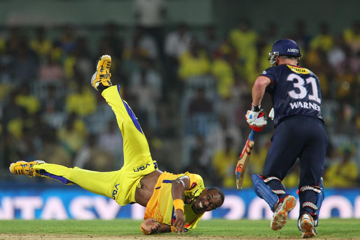 Dwayne Bravo dives to stop the ball from his own bowling during match 64 of the Pepsi Indian Premier League between The Chennai Superkings and the Delhi Daredevils held at the MA Chidambaram Stadium in Chennai on the 14th May 2013..Photo by Ron Gaunt-IPL-SPORTZPICS   .. .Use of this image is subject to the terms and conditions as outlined by the BCCI. These terms can be found by following this link:..https://ec.yimg.com/ec?url=http%3a%2f%2fwww.sportzpics.co.za%2fimage%2fI0000SoRagM2cIEc&t=1493291187&sig=yYPlMmMARZsW07r5.1HVNA--~C