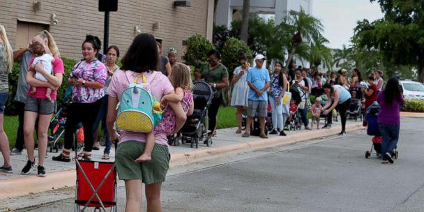 PHOTO: Parents and kids in line for close to an hour at Coral Square mall, for the Build-A-Bear Workshop Pay Your Age Day event, July 12, 2018. (Carline Jean/SF Sun Sentinel/Polaris)